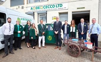 A  De Cecco team celebrate with Chair Alberto De Cecco ( centre left)  and Managing Director Alex Paton ( centre right) (photograph)